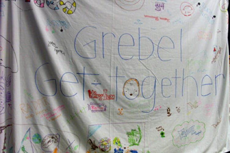 "A piece of cloth that says ""Grebel Get-together"" and is decorated with drawings"