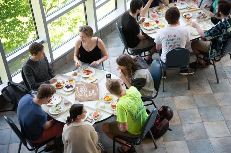 Summer students eat in the upper atrium during construction