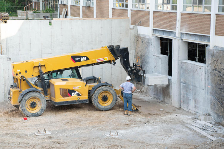 Concrete is removed from foundation by heavy machinery