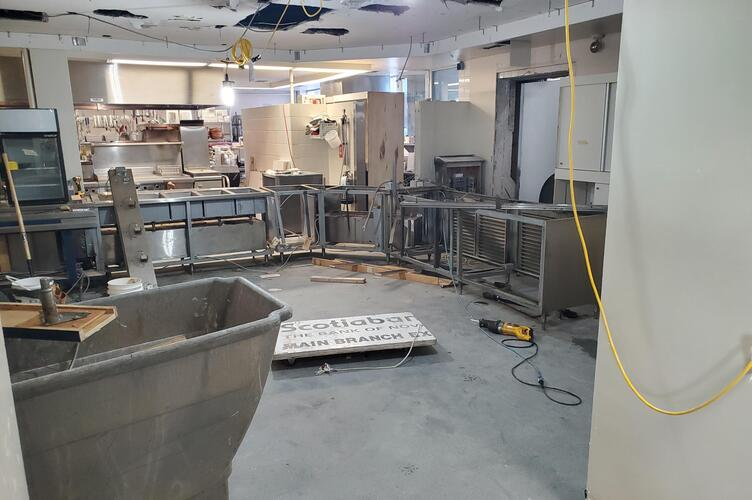 The now old kitchen, being stripped of lighting, counters, and equipment