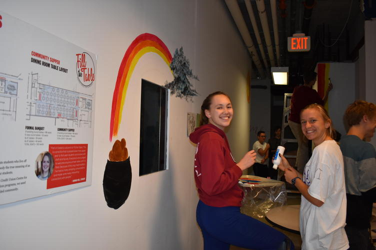 students painting dining room