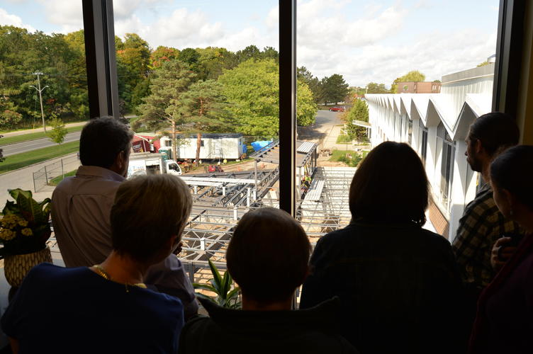 Staff watch as the addition takes shape