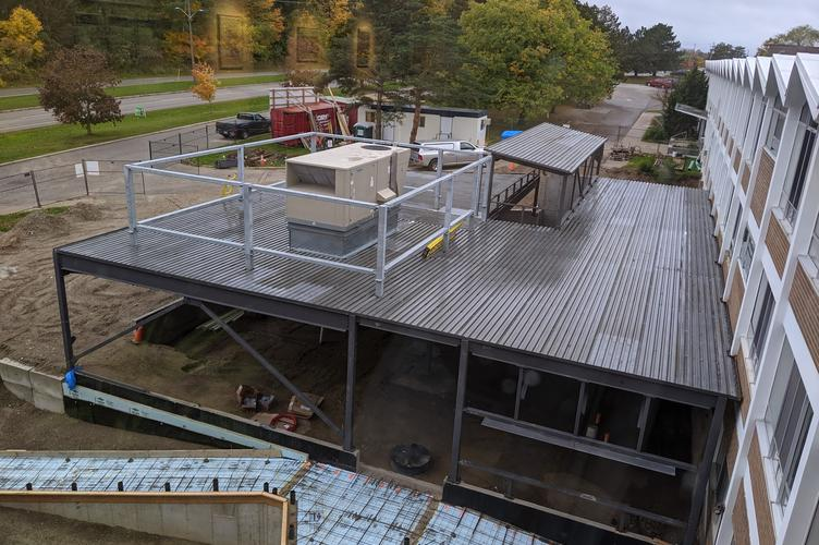 A steel roof and air mover are installed
