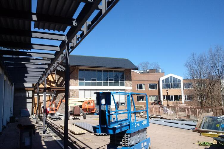Steel goes up outside the grebel patio
