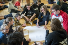 students sitting in a circle during orientaton week