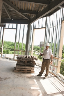 Fred Martin checks out the view in the corner of the MSCU Centre for Peace Advancement.