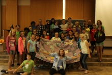 campers with quilt