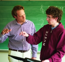 Student and professor in music class