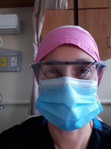 Alisa wears her protective equipment at the hospital