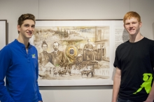 Students Adrian Neufeld and Noah Janzen stand with the painting of their great-great-grandmother, Maria Neufeld.