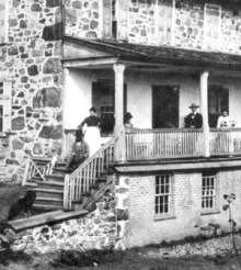 An old photograph of the Brubacher House with Mennonites