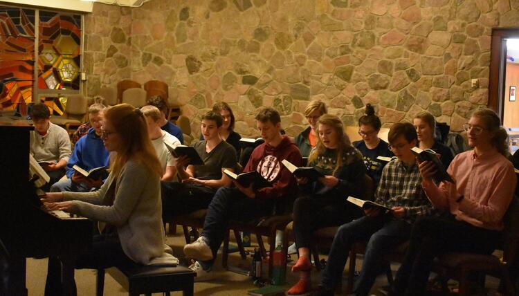 students singing in chapel
