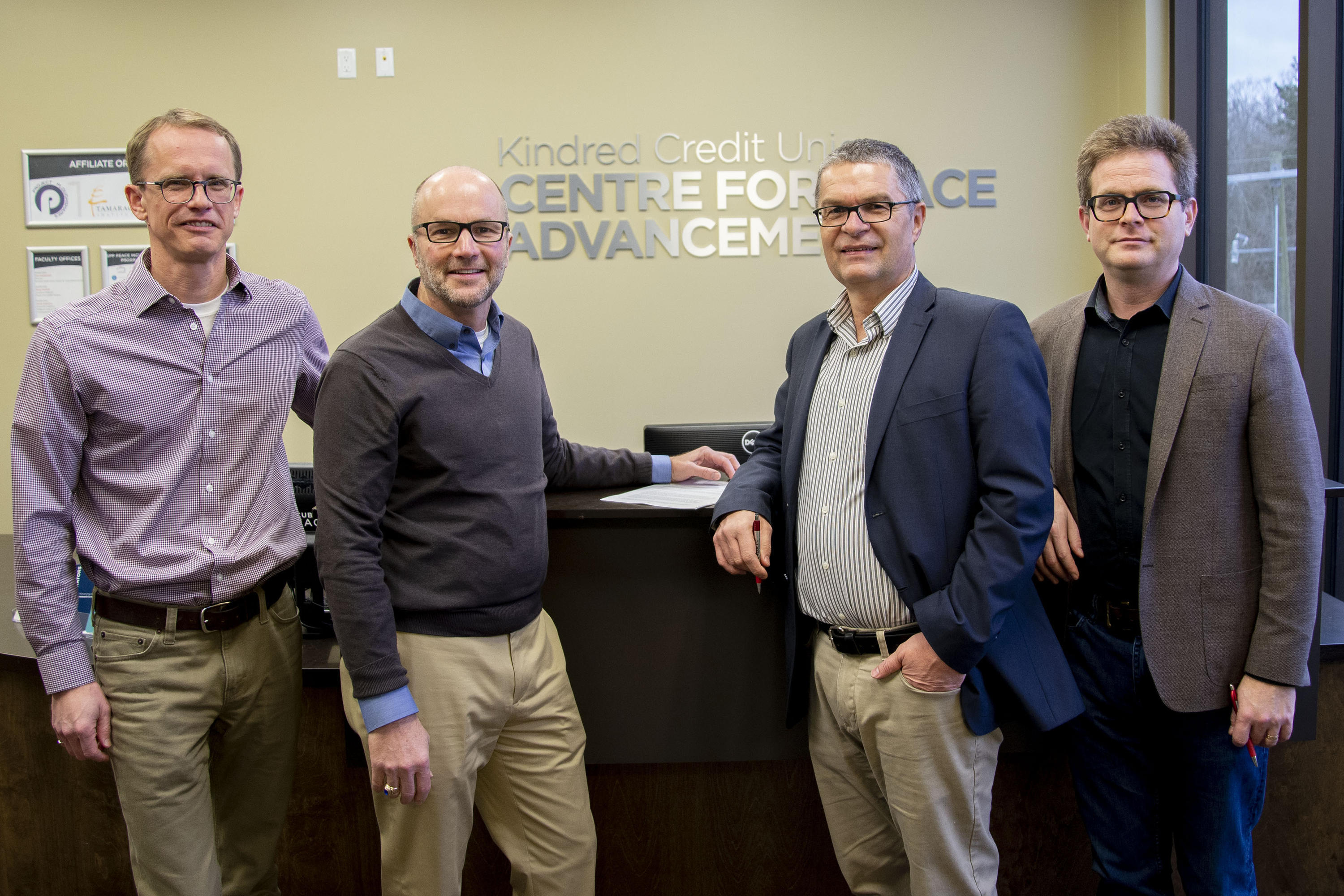 Paul Heidebrecht, John Head, Rick Cober Bauman, and Marcus Shantz pose with signed Memorandum of Understanding