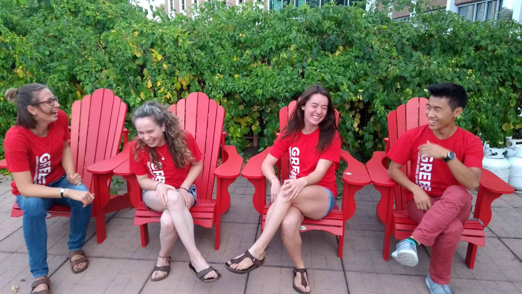 Grebelites sitting on Muskoka chairs
