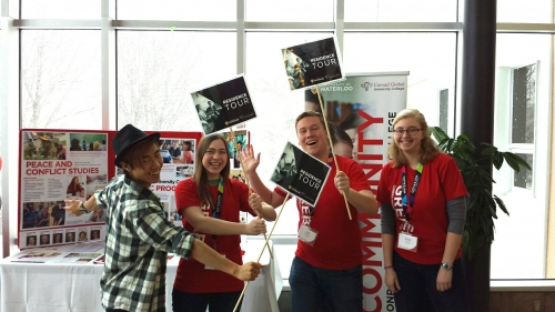 Grebel students holdin tour signs