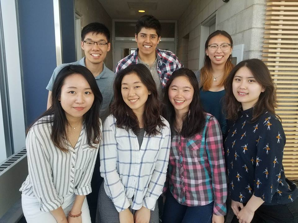 Chemical engineering students celebrating Electric Mobility Canada win