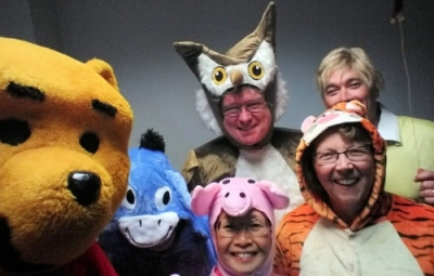 Six deans dressed as Winnie the Pooh characters.