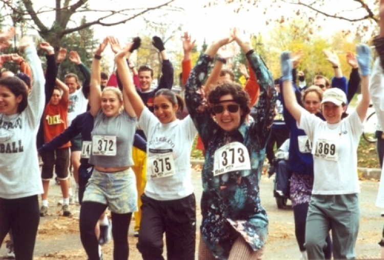fun run participants stretching with arms in the air