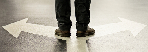 Person's feet and white arrows on floor.