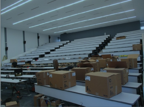 Lecture hall seating installation.