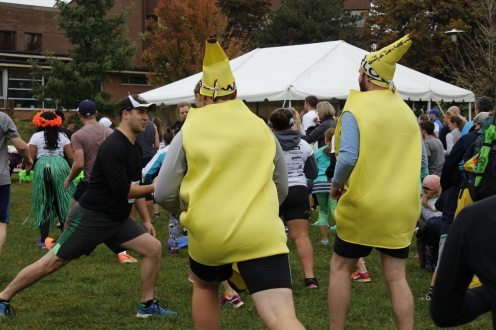 Two racers dressed up in a banana costume