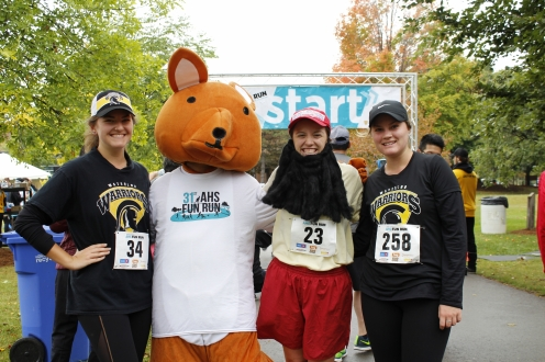 Participants standing with AHSSIE the mascot
