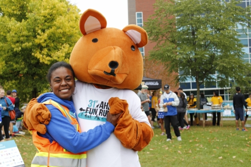 AHSSIE the mascot and a volunteer road marshal