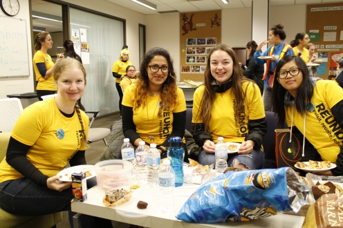 Volunteers eating lunch in the student lounge