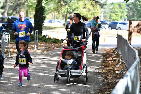 Family with stroller running