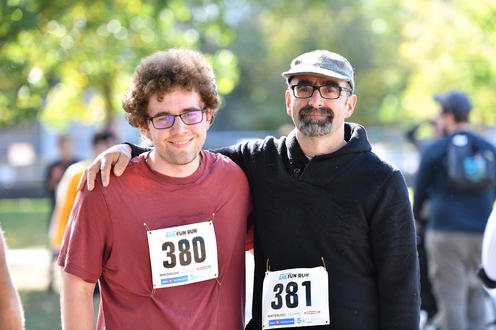 Two male Fun Run participants smiling at the camera