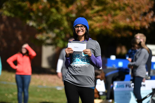 Fun Run prize winner smiling with envelope in hand
