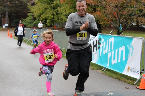 Father and daughter crossing the finish line