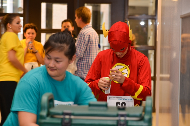 Student dressed as flash character getting a drink