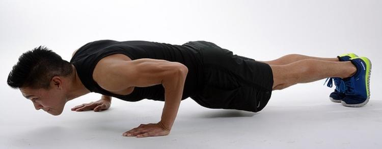 Male doing tricep pushup