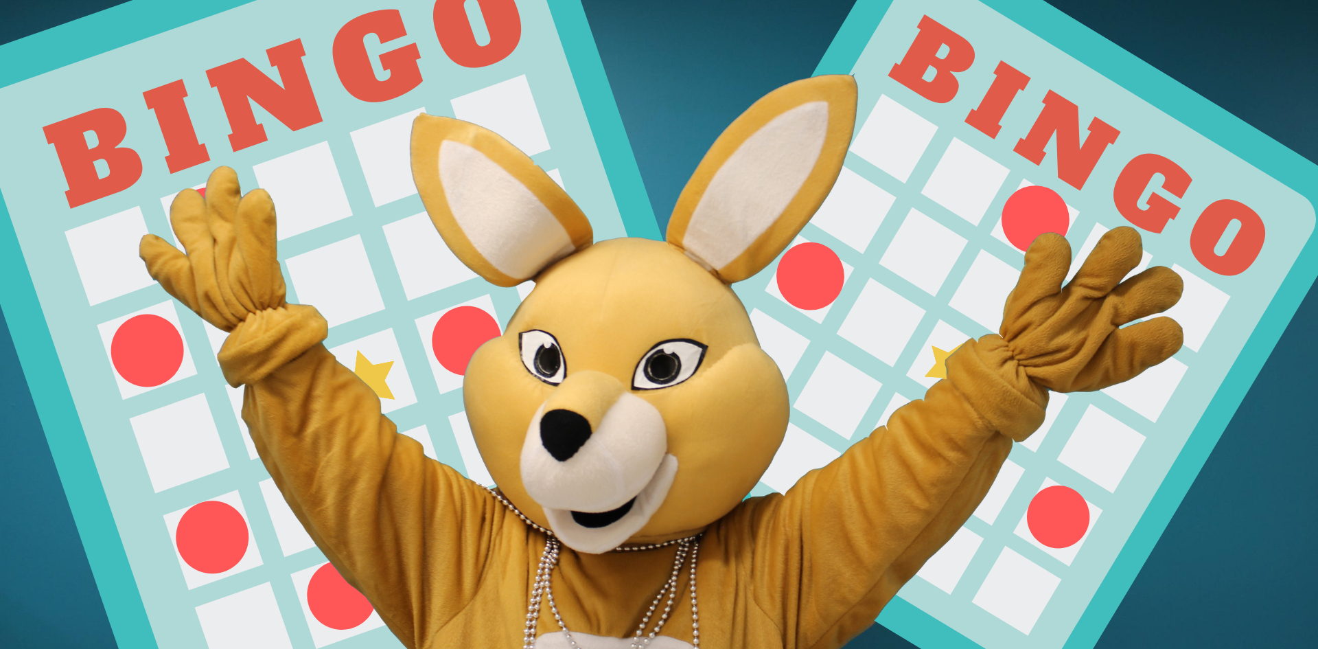 AHSSIE the mascot with arms up in front of bingo card.