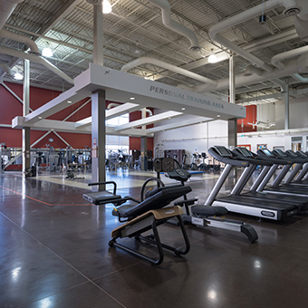 Treadmills and workout equipment in gymnasium.