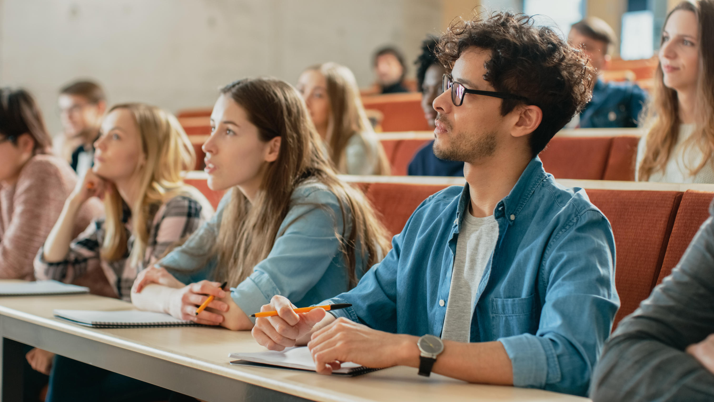 Attentive students in large classroom