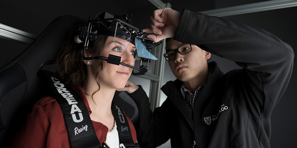 Research participant wearing eye tracking helmut in sensory lab.
