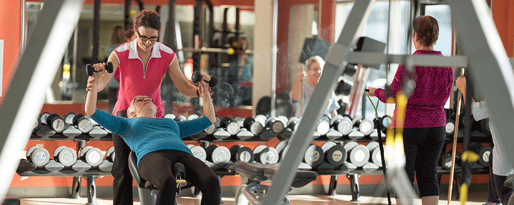 Older women using equipment at the gym.