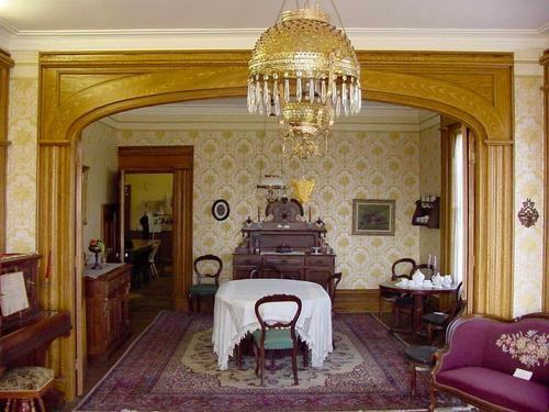 a historic dining room with antique furniture