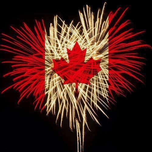 Fireworks at night in the style of the Candian Flag; red and white with a maple leaf in the middle