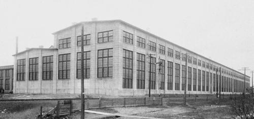 An old photo of the mammoth 1907 Shops building