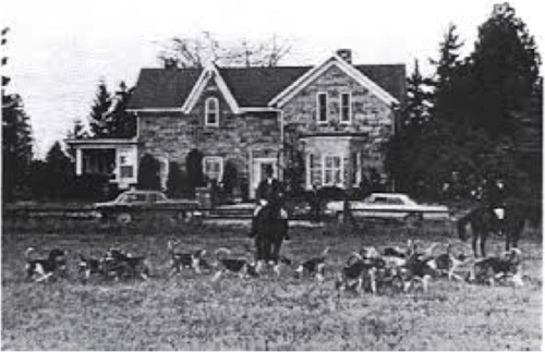 A black and white image of a farm house