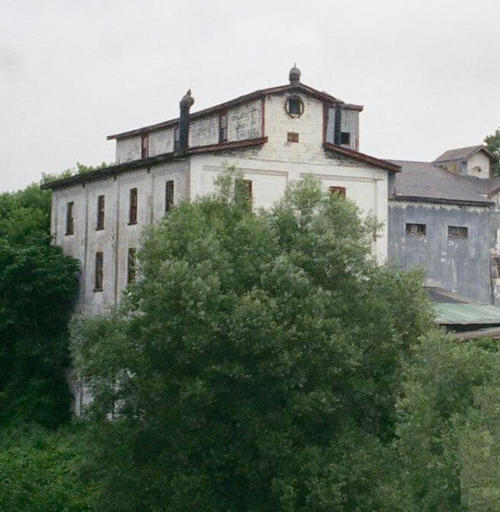 A photo of the Thamesford Mill building surrounded by trees