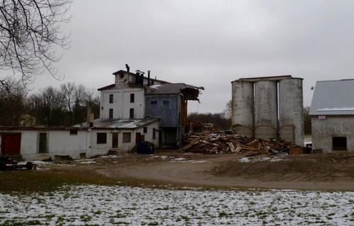 The partially demolished Thamesford Mill building with semi-demolished buildings