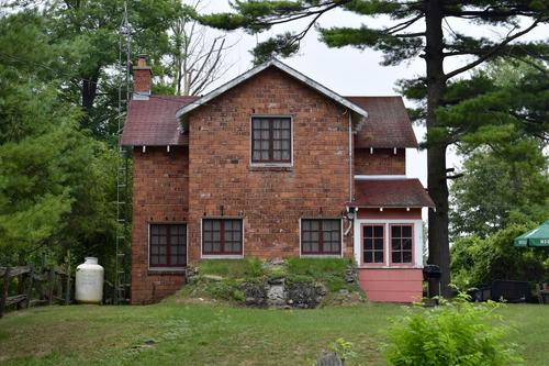 An image of a rare cottage building made of red brick at Rondeau