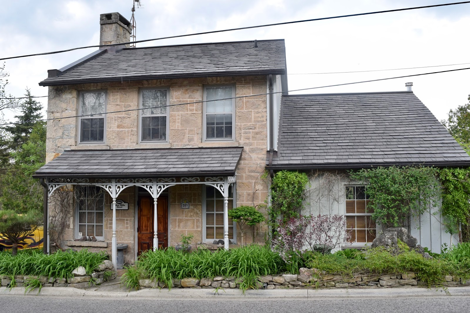 A historic farmhouse used as a hotel in Eden Mills, 1867
