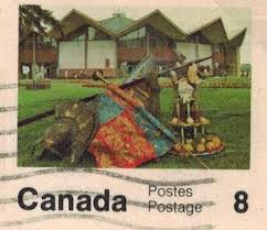 A pink Canadian postage stamp with an image of harvest decorations