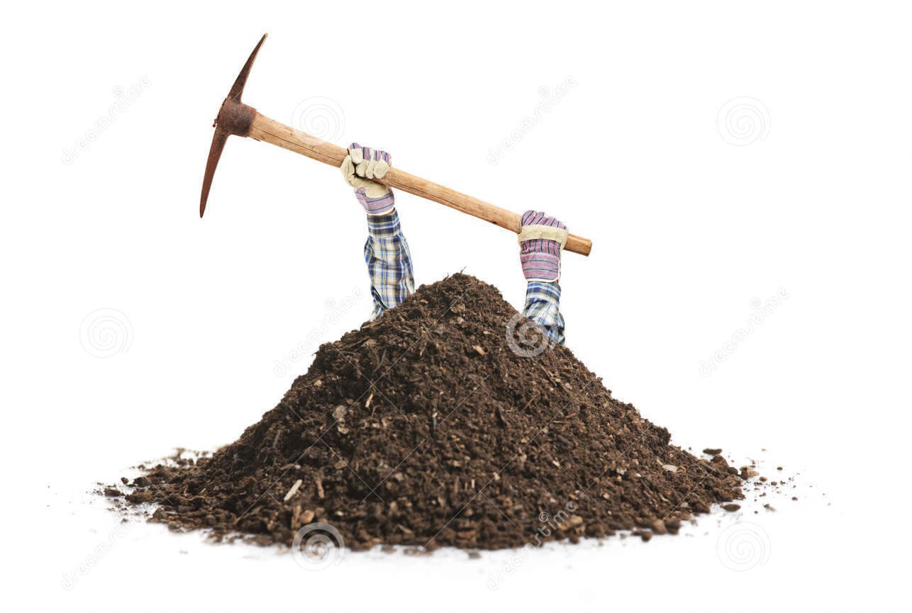 An image of male manual worker hands coming out of a pile of dirt holding a pickaxe