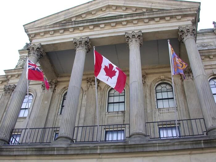 A frontage of a stone Portico of Victoria Hall in Cobourg, Ontario